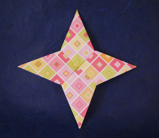 Origami Four-pointed star by John Montroll Folded from a square of scrap-booking paper by Gilad Aharoni on giladorigami.com