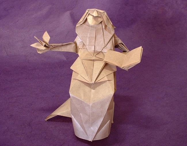 Origami A bird on hand by Watanabe Dai Folded from a square of thin brown wrapping paper by Gilad Aharoni on www.giladorigami.com