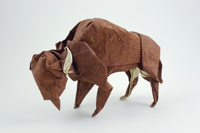 Origami Bison by John Montroll Folded from a square of tea-stained leather scrapbooking paper by Gilad Aharoni on giladorigami.com