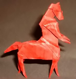 Origami Centaur by Jun Maekawa Folded from a square of dinosaur paper by Gilad Aharoni on giladorigami.com