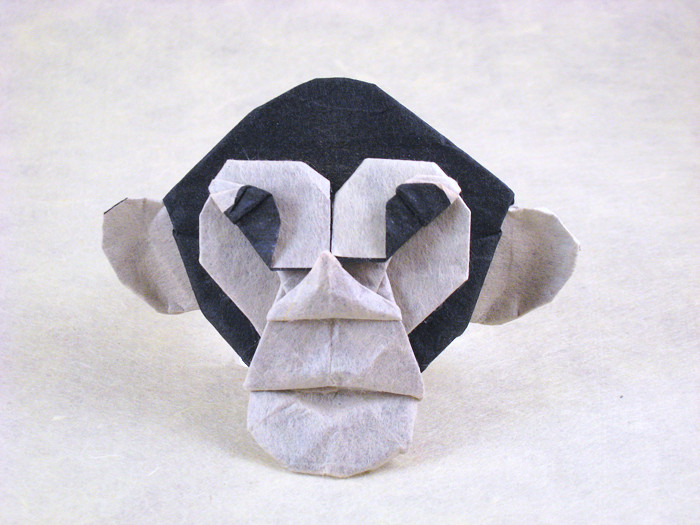 Origami Chimpanzee mask by John Richardson Folded from a square of Mulberry+Lokta paper by Gilad Aharoni on giladorigami.com