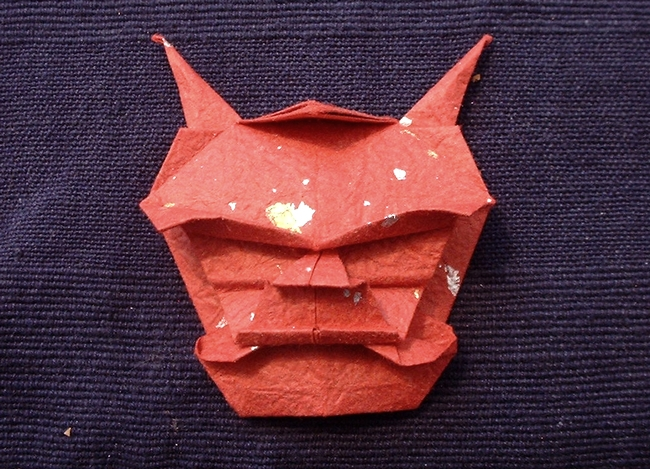 Origami Demon mask by Akira Yoshizawa Folded from a square of momigami by Gilad Aharoni on giladorigami.com