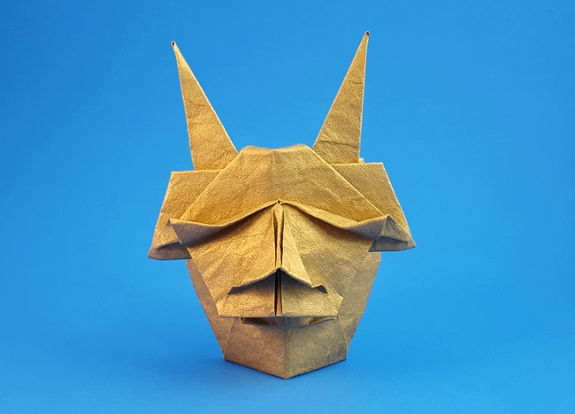 Origami Demon mask by Akira Yoshizawa Folded from a square of India Gold paper by Gilad Aharoni on giladorigami.com