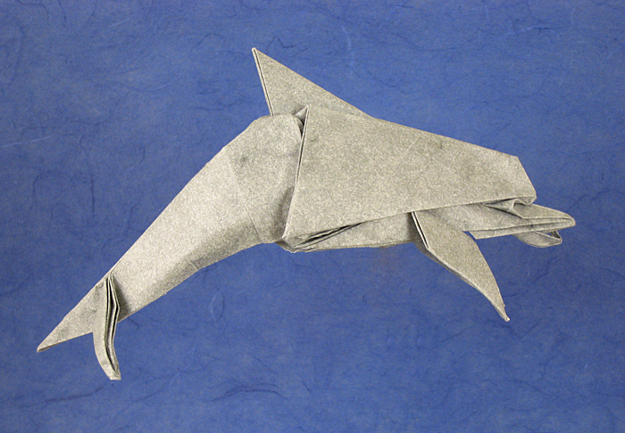 Origami Dolphin by Jason Ku Folded from a square of Elephant-hide by Gilad Aharoni on giladorigami.com