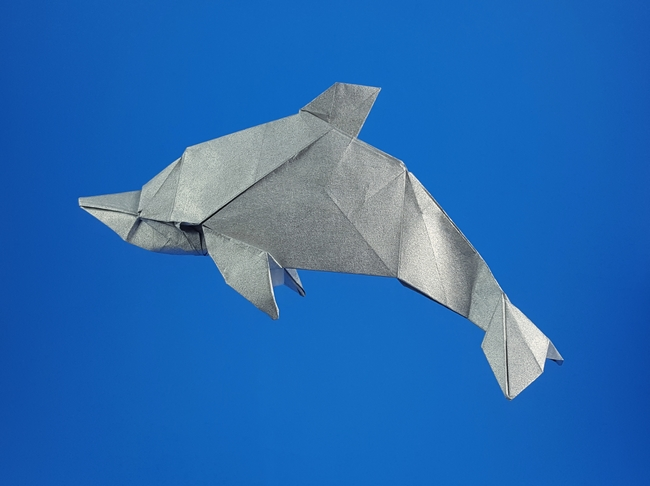Origami Dolphin by Yoo Tae Yong Folded from a square of Nicolas Terry's tissue-foil by Gilad Aharoni on giladorigami.com