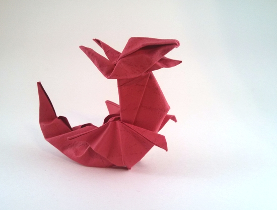 Origami Dragon by Jozsef Zsebe Wet-folded from a square of textured origami paper by Gilad Aharoni on giladorigami.com