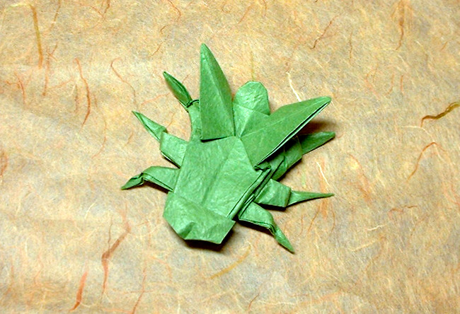 Origami Fly by John Montroll Folded from a square of Vietnamese wrapping-paper by Gilad Aharoni on giladorigami.com