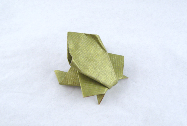 Origami Frog - jumping by Akira Yoshizawa Folded from a square of scrap-booking paper by Gilad Aharoni on giladorigami.com