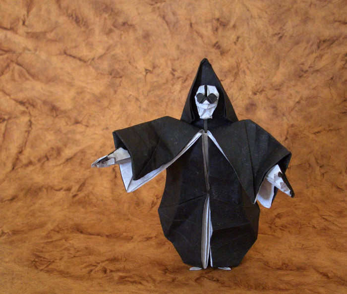 Origami Grim Reaper by Miyajima Noboru Folded from a square of duo tissue, treated with MC by Gilad Aharoni on giladorigami.com