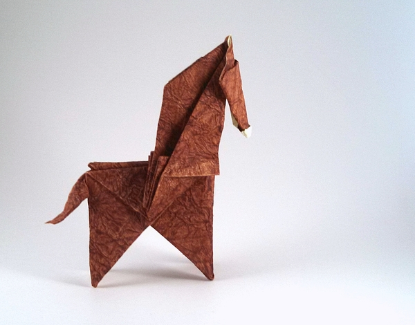 Origami Horse by Seo Won Seon (Redpaper) Folded from a square of Tea Stained Leather scrap-booking paper by Gilad Aharoni on giladorigami.com