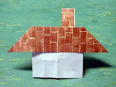 Origami House with a chimney by Sy Chen folded by Gilad Aharoni