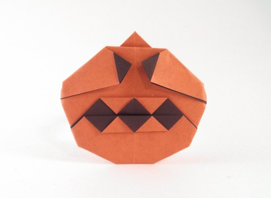Origami Jack-O-Lantern by Nick Robinson Folded from a square of duo origami paper by Gilad Aharoni on giladorigami.com