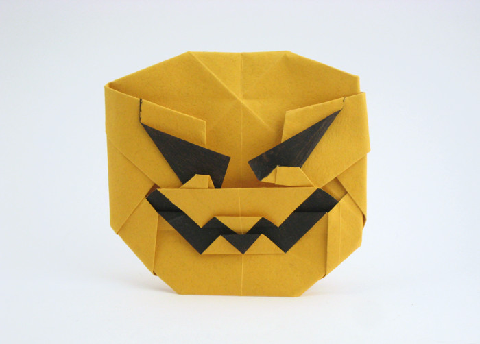 Origami Jack-O-lantern by Roman Diaz Folded from a square of Tant paper by Gilad Aharoni on giladorigami.com