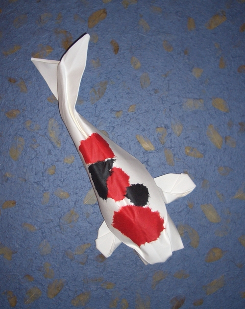 Origami Koi by Michael G. LaFosse with application of colored paper for the spots by Gilad Aharoni on giladorigami.com