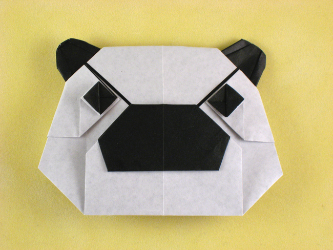Origami Panda mask by Juan Gimeno Folded from a square of origami paper by Gilad Aharoni on giladorigami.com
