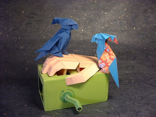 origami macaw parrot on a hand Stock Photo - Alamy | 488x650