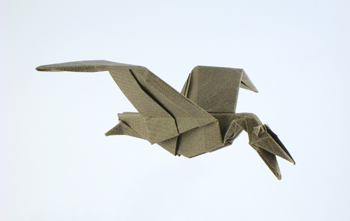 Origami Pterodactylus by John Montroll Folded from a square of textured origami paper by Gilad Aharoni on www.giladorigami.com