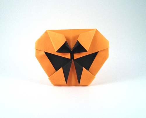 Origami Jack-O-lantern by Ynyr Lloyd Folded from a square of watercolor paper by Gilad Aharoni on giladorigami.com