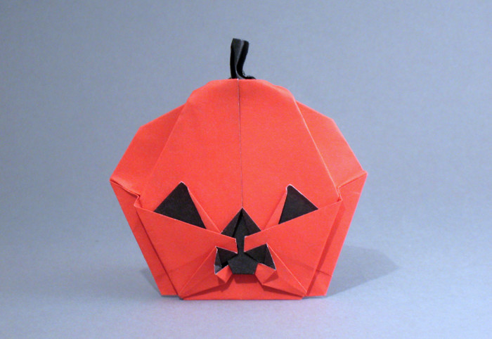 Origami Jack-O-lantern by Kalei Anne Lundberg Folded from a square of duo origami paper by Gilad Aharoni on giladorigami.com
