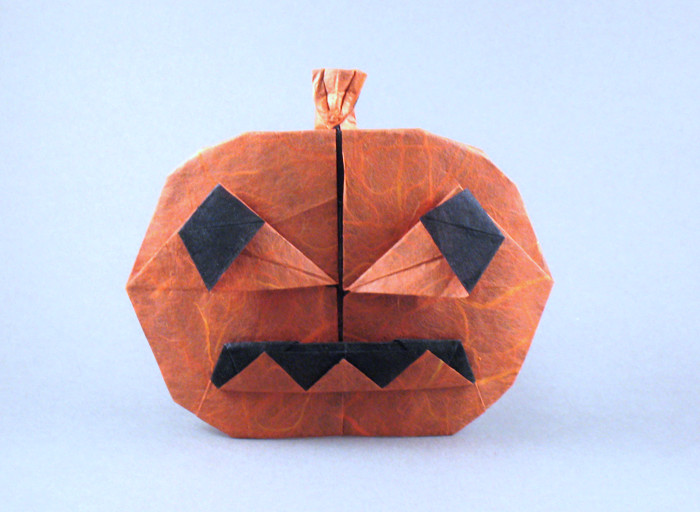 Origami Jack-O-lantern by Sara Wooden Folded from a square of double-sided Unryu paper by Gilad Aharoni on giladorigami.com