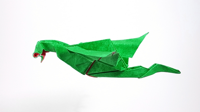 Origami Razorback dragon by Paul Frasco Wet folded from a square of paper provided in the kit by Gilad Aharoni on www.giladorigami.com