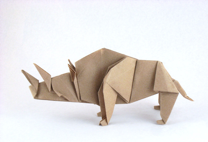 Origami Rhinoceros by Kunihiko Kasahara Folded from a square of Trimaco masking paper by Gilad Aharoni on giladorigami.com