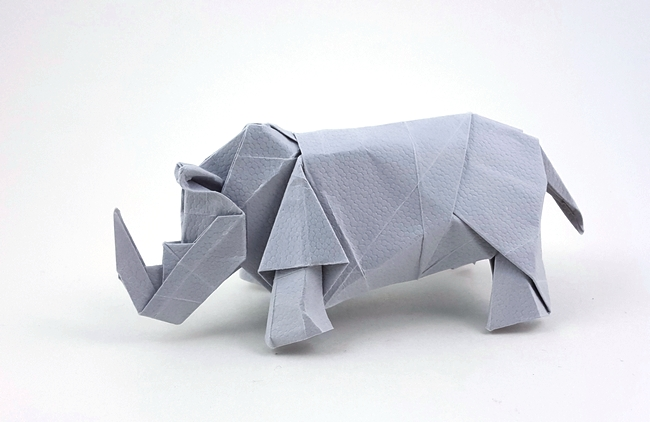 Origami Rhinoceros by Hideo Komatsu Folded from a square of lizard hide paper by Gilad Aharoni on giladorigami.com