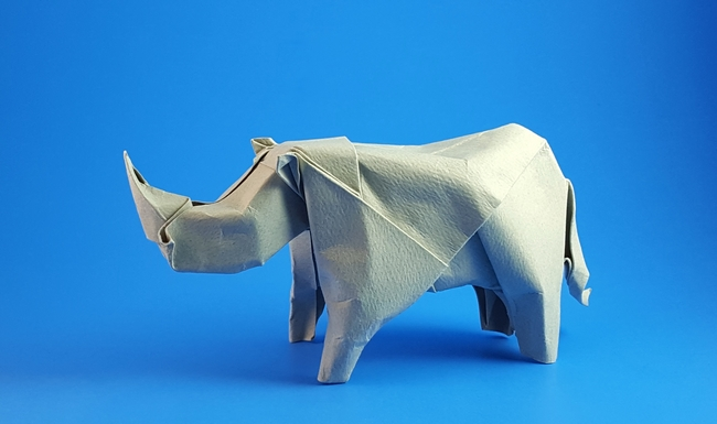Origami Rhinoceros by Angel Morollon Guallar Wet folded from a square of cardstock by Gilad Aharoni on giladorigami.com
