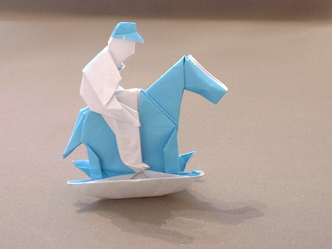 Origami Boy On A Rocking Horse By Neal Elias Folded From Square Of Paper