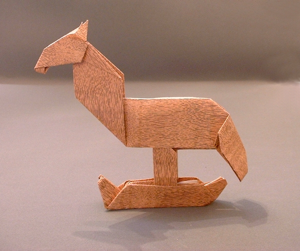 Origami Rocking horse by Alfredo Giunta folded from a rectangle of wood-like paper by Gilad Aharoni on giladorigami.com