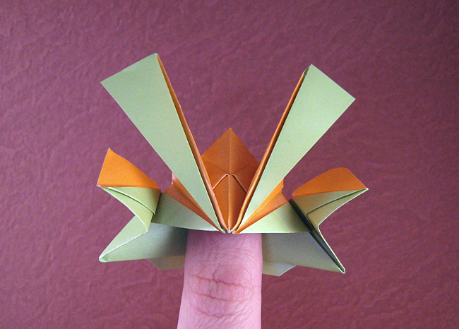 Origami Samurai helmet by Jun Maekawa Folded from a square of duo pearl origami paper by Gilad Aharoni on giladorigami.com