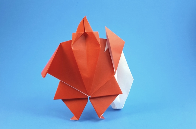 Origami Santa with bag by Akira Yoshizawa Folded from 2 squares of origami paper by Gilad Aharoni on giladorigami.com