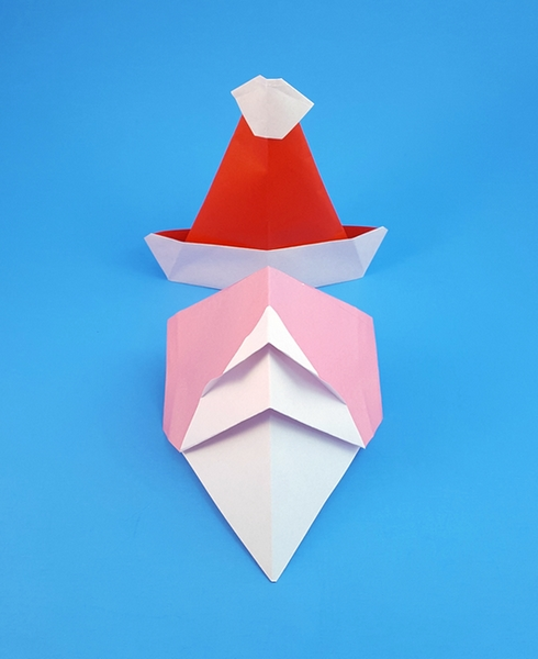 Origami Santa hat by Akira Yoshizawa Folded from a square of origami paper by Gilad Aharoni on giladorigami.com