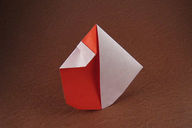 Origami Santa - rocking by David Petty Folded from a square of origami paper by Gilad Aharoni on giladorigami.com