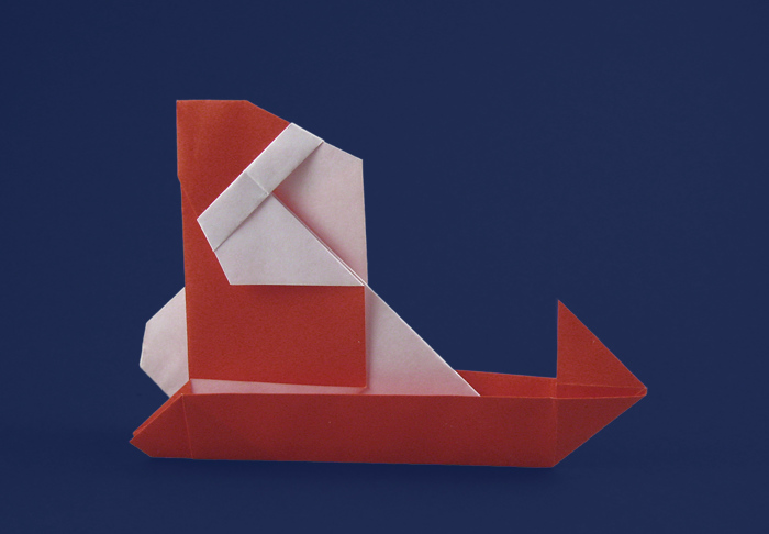 Origami Santa Claus and sled by Sanae Sakai Folded from a square of origami paper by Gilad Aharoni on giladorigami.com