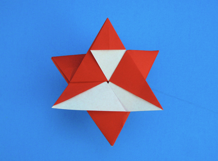 Origami Santa Claus star by Fumiaki Shingu Folded from a square of origami paper by Gilad Aharoni on giladorigami.com