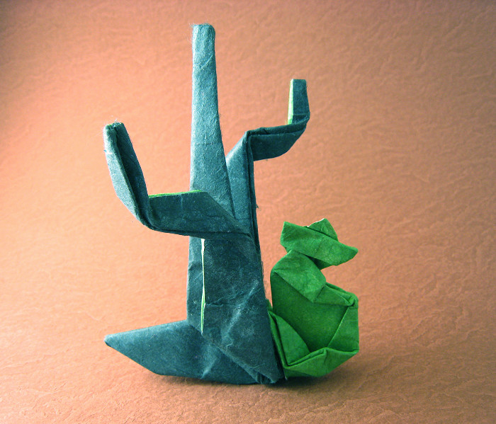 Origami Siesta - man with cactus by Neal Elias Wet-folded from a square of double-sided mulberry paper by Gilad Aharoni on giladorigami.com