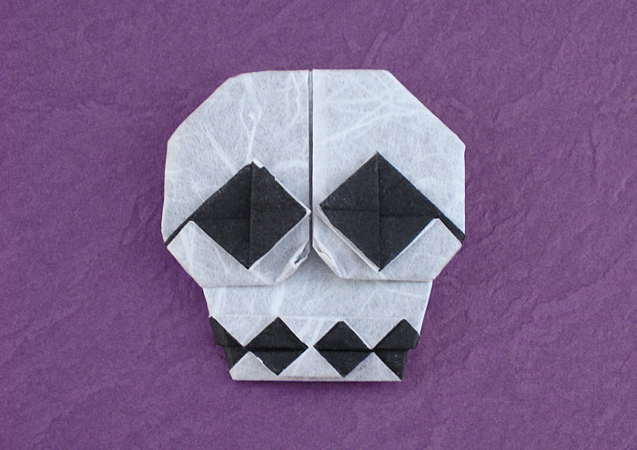 Origami Skull by Yoshihide Momotani Folded from a square of double-sided Unryu paper by Gilad Aharoni on giladorigami.com