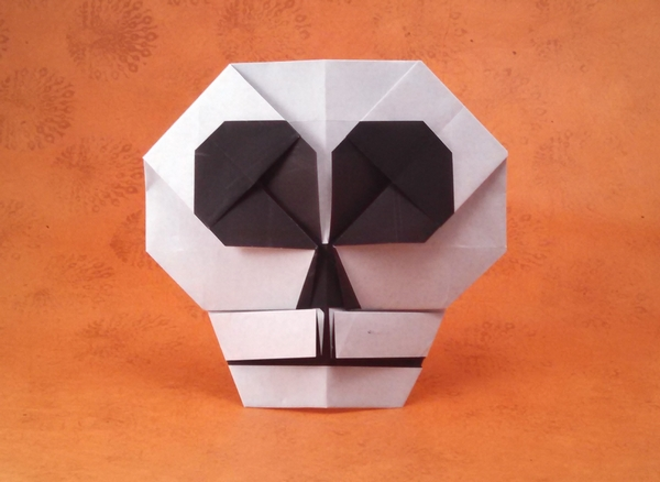 Origami Skull emblem by Hojyo Takashi Folded from a square of origami paper by Gilad Aharoni on giladorigami.com