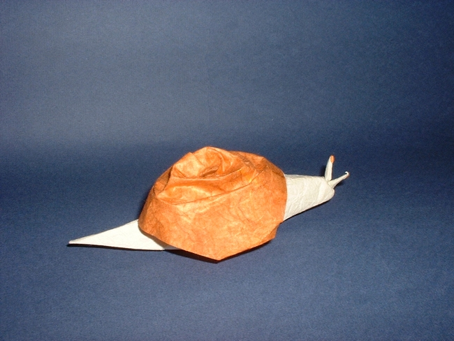 Origami Snail by Akira Yoshizawa Folded from a square of rice paper by Gilad Aharoni on giladorigami.com