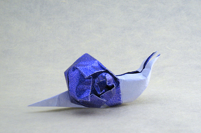 Origami Snail by Jozsef Zsebe Folded from a square of Kathy Stevick's tissue-foil by Gilad Aharoni on giladorigami.com