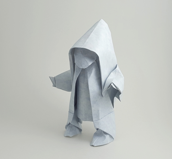 Origami Snow Child by Akira Yoshizawa Wet folded from a square of Astroparche textured cardstock by Gilad Aharoni on giladorigami.com