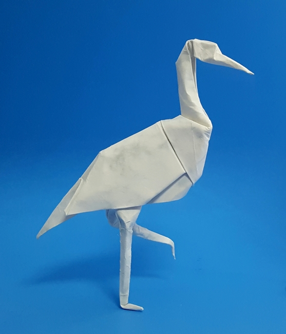 Origami Stork by John Montroll Wet folded from a square of Royal Marble scrapbooking paper by Gilad Aharoni on giladorigami.com
