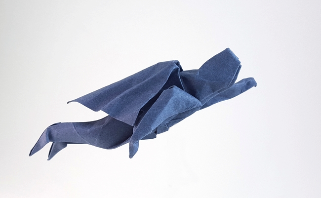 Origami Superman flying by John Montroll Folded from a square of Canson art paper by Gilad Aharoni on giladorigami.com