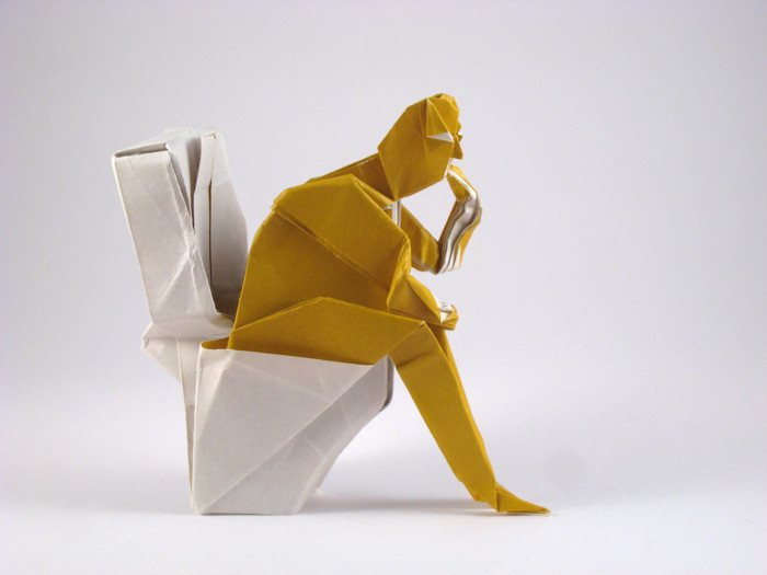 origami man on toilet