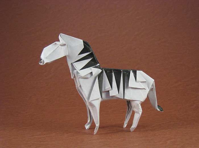 Origami Zebra by John Montroll Folded from a square of origami paper by Gilad Aharoni on giladorigami.com