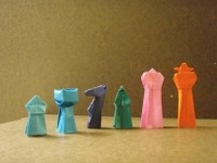 Origami Chess pieces by John Montroll on giladorigami.com