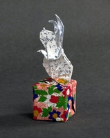 Origami Rabbit on a cube by Fred Rohm on giladorigami.com