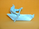 Origami Boat with an Indian paddling by Robert J. Lang on giladorigami.com