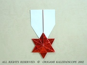 Origami Star medal by Francis Ow on giladorigami.com